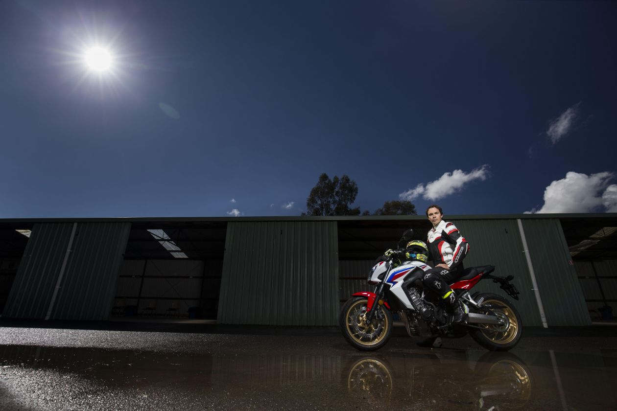 Chris Vermeulen riding his motorbike in the wet